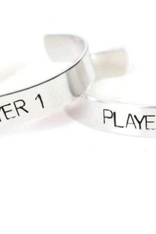 PLAYER 1 and PLAYER 2 pair of aluminum metal stamped cuff bracelets